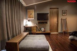 Habitaciones de estilo moderno por Nómada Studio