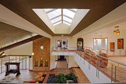 Projekty,  Ogród zimowy zaprojektowane przez JAYESH SHAH ARCHITECTS
