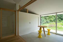 モンタージュ2: Smart Running一級建築士事務所が手掛けた廊下 & 玄関です。