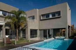 Casas de estilo minimalista por Remy Arquitectos