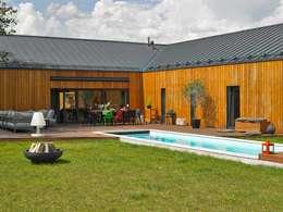 Dom: styl nowoczesne, w kategorii Domy zaprojektowany przez stando interior design