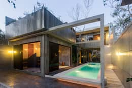 Piscinas de estilo moderno por Studio Arquitectos