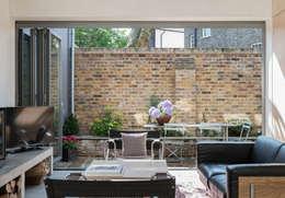 The Workshop: modern Living room by Henning Stummel Architects Ltd