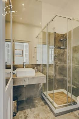 Banheiros rústicos por Obrasdecor