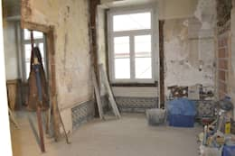 rustic Living room by Obrasdecor