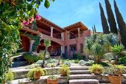 Casa Sancho: Jardines de estilo clásico por Terra