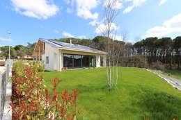 Projekty, nowoczesne Domy zaprojektowane przez marco carlini architetto