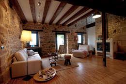 RUBIO · BILBAO ARQUITECTOS: kırsal tarz tarz Oturma Odası