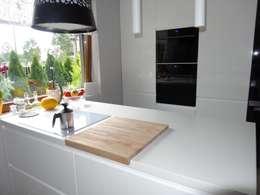 Białe blaty kuchenne Stone Italiano: styl , w kategorii Kuchnia zaprojektowany przez Merkam  - Łódź ul. Św. Jerzego 9
