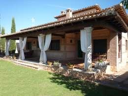 VIVIENDA RURAL: Casas de estilo rural de CARLOS TRIGO GARCIA