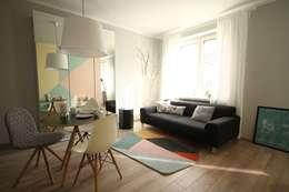 mieszkanie w stonowanej kolorystyce : styl , w kategorii Salon zaprojektowany przez Archomega