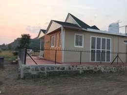 Casas de estilo rural por Square7 Architects & Interior Designers