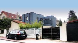 Sur-élévation en ossature bois traditionnelle: Maisons de style de style Moderne par AADD+