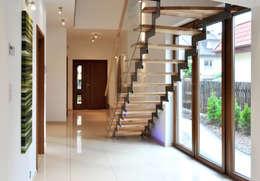 Corridor & hallway by Biuro Projektów MTM Styl - domywstylu.pl