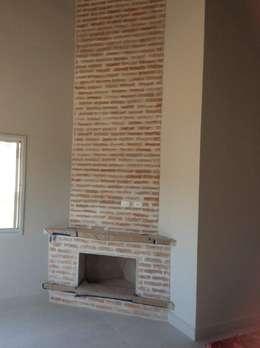 rustic Living room by Vanda Carobrezzi - Design de Interiores
