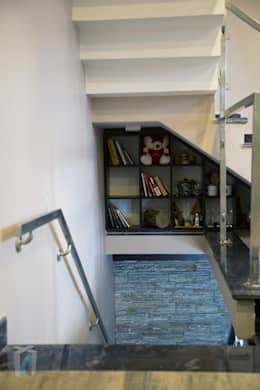 Under staircase storage design:  Corridor, hallway & stairs  by Bonito Designs Bangalore