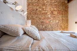 Dormitorios de estilo ecléctico por Espacios y Luz Fotografía