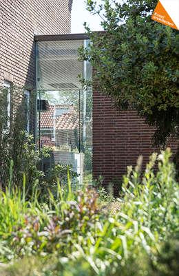 Uitbreiding hoekwoning Amersfoort: moderne Huizen door Kraal architecten BNA