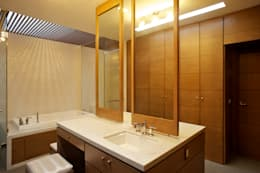 Baños de estilo moderno por Tacher Arquitectos