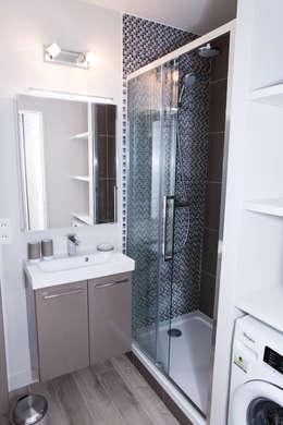 Salle de bain après - Appartement Courbevoie:  de style  par Nuance d'intérieur