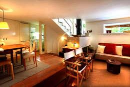 Salas de estilo moderno por MANUEL CORREIA FERNANDES, ARQUITECTO E ASSOCIADOS