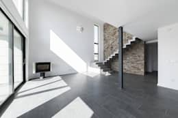 Salas de estar modernas por AD+ arquitectura