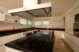 Cocinas de estilo moderno por MiD Arquitectura
