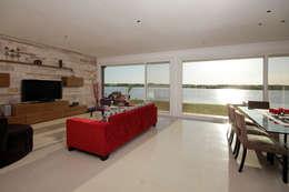 Salas / recibidores de estilo moderno por MiD Arquitectura