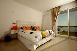 Casa MaLi: Dormitorios de estilo moderno por MiD Arquitectura