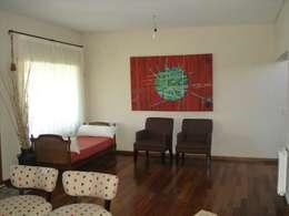ห้องนั่งเล่น by Fainzilber Arqts.
