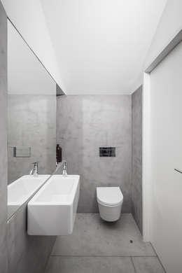 minimalistische Badkamer door URBAstudios