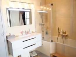Réhabilitation d'un appartement à Strasbourg: Salle de bains de style  par Ae-design