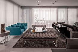 Living e Jantar Integrados com Home Theater: Sala de estar  por FV