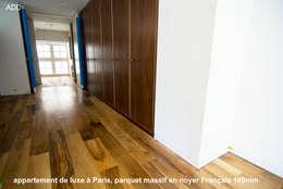 Appartement réhabilité , fourniture des parquets en noyer Français ADD  20X180X1800mm: Couloir et hall d'entrée de style  par ADD
