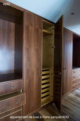 Appartement réhabilité , fourniture des parquets en noyer Français ADD  20X180X1800mm: Dressing de style de style Moderne par ADD