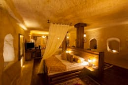 Kayakapi Premium Caves - Cappadocia – Kuşçular Konağı Öncesi Ve Sonrası: rustik tarz tarz Yatak Odası