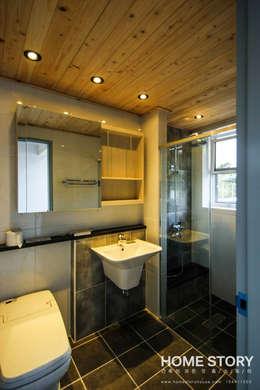 [상주전원주택 인테리어] 2세대가 함께 사는 프라이버시가 보호되는 세대분리형 ALC주택: (주)홈스토리의  화장실