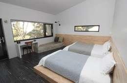 비로소 4´33´´ 게스트 하우스 : 아키제주 건축사사무소의  침실