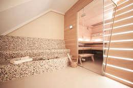 Dachgeschosswohnung: klassisches Spa von Cordier Innenarchitektur