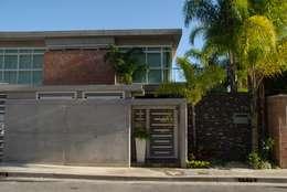 Casas de estilo minimalista por Arquitecto Juan Pablo Fernandes