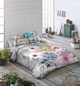 Camera da letto in stile in stile Moderno di TEXTIL ANTILO