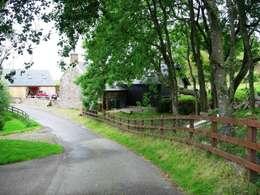 Projekty, wiejskie Domy zaprojektowane przez Roundhouse Architecture Ltd