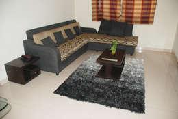Living room: modern Bedroom by VGA Designers