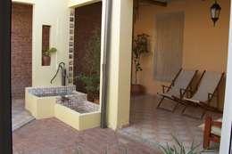 Jardines de estilo rústico por milena oitana