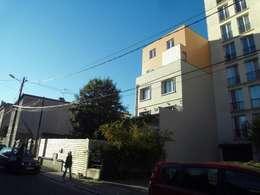 Façade sur rue: Maisons de style de style Moderne par Paula Bianco