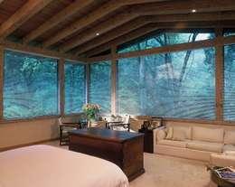 Dormitorios de estilo clásico por JR Arquitectos