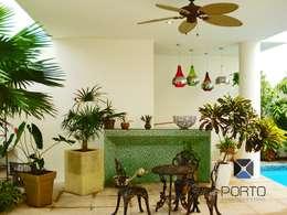 Patios by PORTO Arquitectura + Diseño de Interiores