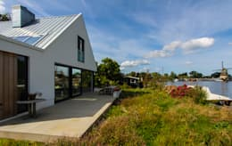 Projekty, nowoczesne Domy zaprojektowane przez ScanaBouw BV