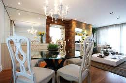 Apartamento Pinheiros 2: Salas de jantar modernas por Officina44