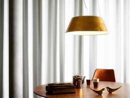 Salas de jantar modernas por Griscan diseño iluminación